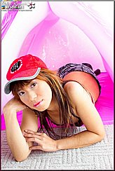 Calyn Rine Playing With Inflatable Wearing Red Cap