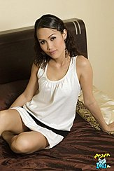 Sitting On Bed Wearing White Dress
