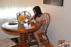 Seated At Table Wearing Demim Shorts In High Heels
