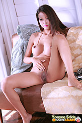Yooyee Srida Seated Naked On Couch Long Hair Big Tits Hand On Her Shaved Pussy Legs Open Bare Feet