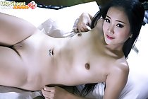 Lying naked on bed looking up small breasts shaved pussy