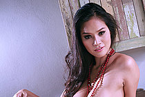 Busty Mali Tai Bares Big Breasts And Masturbates Shaved Pussy
