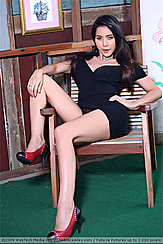 Sitting On Chair Leaning Back Hand On Hip In Black Dress Upskirt Panties In Crimson High Heels