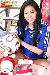 Sitting Cross Legged Holding Ball Wearing Japan Football Shirt