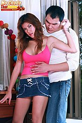 Wearing Pink Top In Denim Skirt Long Hair Boyfriend Embracing Her From Behind