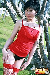 Standing Beside Tree Wearing Red Top In Fishnet Stockings