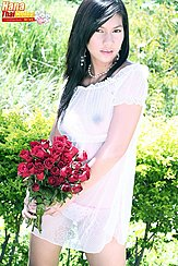 Holding Bunch Of Flowers In See Through Dress