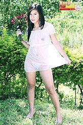 Pulling Hem Of Transparent Dress Holding Flowers