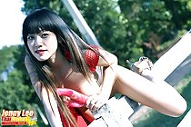 Astride fence wearing high heels long hair holding vibrator