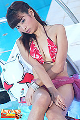 Seated Beside Pool Wearing Bikini Top Legs Pressed Together