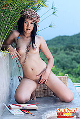 Sandy Ari Kneeling Nude Necklace Between Her Small Breasts Hand On Her Pussy