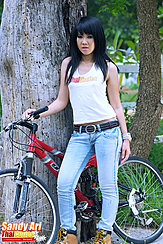 Standing Under Tree With Bike Wearing Jeans