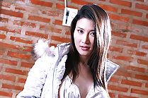 Sophia Chui strips silver jacket and shorts wearing boots