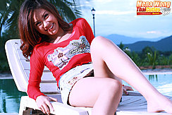 Reclining On Sun Lounger Wearing Short Skirt
