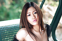 Pretty Olive Nar strips on swing seat and bare her small breasts