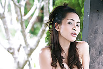 Soda Nuch strips red shorts outdoors and bare her pert breasts