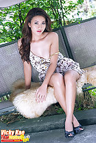 Seated cross legged dress fallen from her bare shoulder long hair