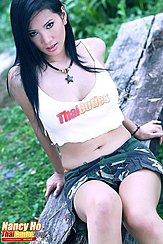 Sitting On Bench Wearing Crop Top In Short Skirt