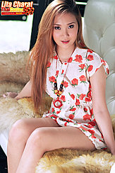 Seated On Couch Wearing Dress Long Hair