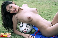 May Supha Reclining Nude On Football Long Hair Pert Breasts