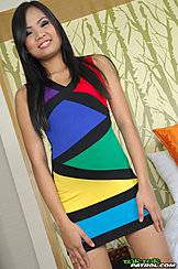 Wearing Colourful Dress Long Hair Hands Down By Her Sides