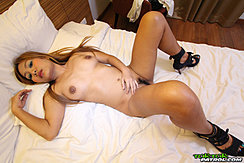 Lying Naked On Bed In High Heels Bare Breasts Trimmed Pussy Hair High Heels