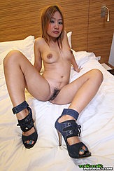 Seated Naked On Bed Legs Open Showing Her Pussy High Heels