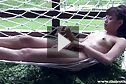 Cutie Angy Lung naked in hammock applying lotion
